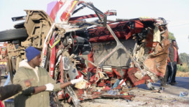 The wreckage of a bus and a truck