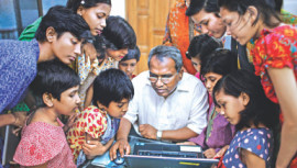 Dr Ehsan Hoque with underprivileged and orphaned children